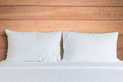 White bedding sheets and pillow in hotel room Royalty Free Stock Photos