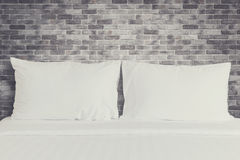 White bedding sheets and pillow in hotel room Royalty Free Stock Images