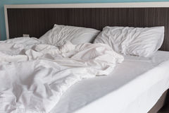 White bedding sheets and pillow, Messy bed concept Stock Photography