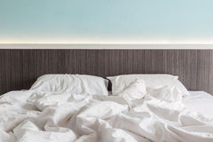 White bedding sheets and pillow, Messy bed concept Stock Images