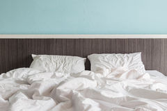 White bedding sheets and pillow, Messy bed concept Stock Photo