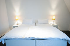 White bedroom. Interior of a hotel bedroom in white colors Stock Photo