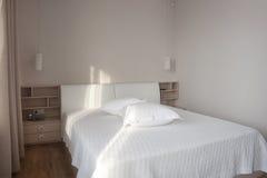 White bedroom. Modern design white sunny  bedroom Stock Photos