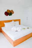 White bedroom. Wood bed in white bedroom Royalty Free Stock Images