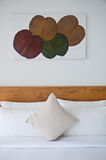 White bedroom. Close up of pillows and picture on wall decoration Stock Photo
