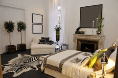 White Bedroom with Fireplace, Zebra Rug, Modern Home  Decoration Royalty Free Stock Photos