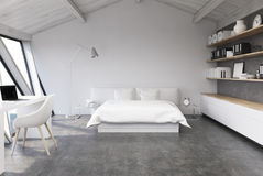 White bedroom in an attic, concrete Royalty Free Stock Image