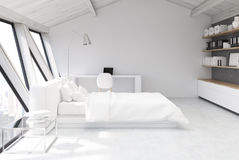 White bedroom in an attic, side view Royalty Free Stock Photography