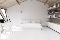White bedroom in an attic Stock Photography