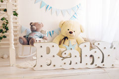 White bedroom with blue decorations designed and teddy bear ideal for both boys and girls Royalty Free Stock Photo