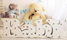 White bedroom with blue decorations designed and teddy bear ideal for both boys and girls Stock Photo