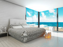 White bedroom interior in a maritime style and sea view Stock Photo