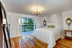 White bedroom interior with walkout deck Stock Image