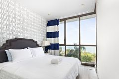 White bedroom with sea view stock photo