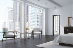White bedroom with two armchairs. White bedroom interior with a white cover bed, two white armchairs, a dark wooden floor and a loft window. 3d rendering Stock Image