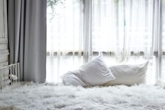 White bedroom with white curtain on window stock image