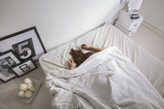 The white bedroom. Woman sleeping on the bed. Stock Photography