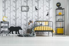 White bedroom with yellow clock royalty free stock images