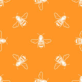 White bees orange background vector seamless pattern Royalty Free Stock Image
