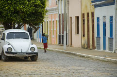 White beetle in the street. Boy walking in a street of Fotuleza Brasil Stock Photo