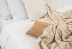 White and beige bedding. Pillows and crumpled sheets, white linen cloth, abstract background Royalty Free Stock Photography