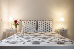 White and beige elegant bedroom Stock Photography