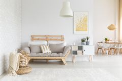 White and beige living room. White, beige and gold furniture and decorations in living room stock photography