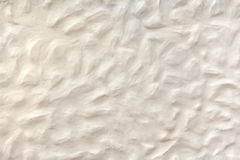White beige plasterwork with bumpy surface Royalty Free Stock Photo