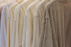 White and beige robes hanging Royalty Free Stock Photos