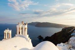 White belfries Santorini island, Greece royalty free stock photo