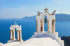 White belfries Santorini island, Greece Royalty Free Stock Photography