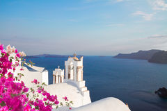 White belfries Santorini island, Greece. White church belfries against volcano caldera at spring day, beautiful details of Santorini island, Greece Stock Photography