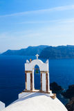 White belfries Santorini island, Greece Stock Photo