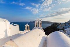 White belfries Santorini island, Greece Royalty Free Stock Photos