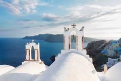 White belfries Santorini island, Greece Stock Images