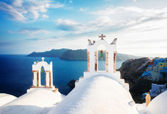 White belfries Santorini island, Greece Stock Image