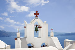 White belfry in the Santorini Island, Cyclades in Greece. Royalty Free Stock Image