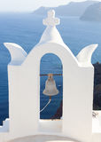 White bell tower at Oia, Santorini, Greece. Stock Images