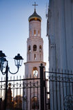 White bell tower at sunset. Large snow-white bell tower of the Orthodox church at sunset royalty free stock image