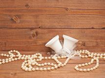 White bells against the wooden background Stock Images