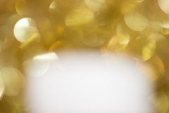White below gold sparkles Royalty Free Stock Image
