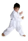 White Belt. Four year old boy showing off his karate moves.  Clipping path included Stock Photography