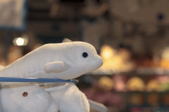 White beluga toy store. Toys on the shelf waiting for purchases royalty free stock photos