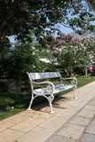 White bench. Beautiful white bench in the park Royalty Free Stock Image