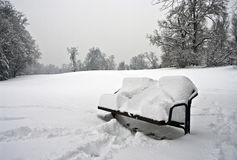 White Bench. Winter scene with park bench Royalty Free Stock Photo