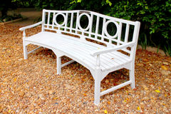 White bench on brown rock Royalty Free Stock Photography