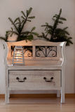 White bench with christmas sprig Stock Photography