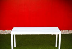White bench in the garden Royalty Free Stock Images