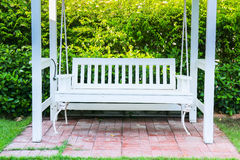 White bench in the garden stock image