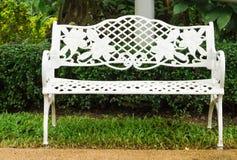 White bench in garden Royalty Free Stock Photo